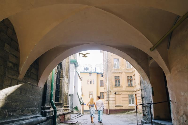 Romantic couple on a walk in France, summer honeymoon in europe with young family on a trip in old town, walking in old alley way. Romantic couple on a walk in stock image