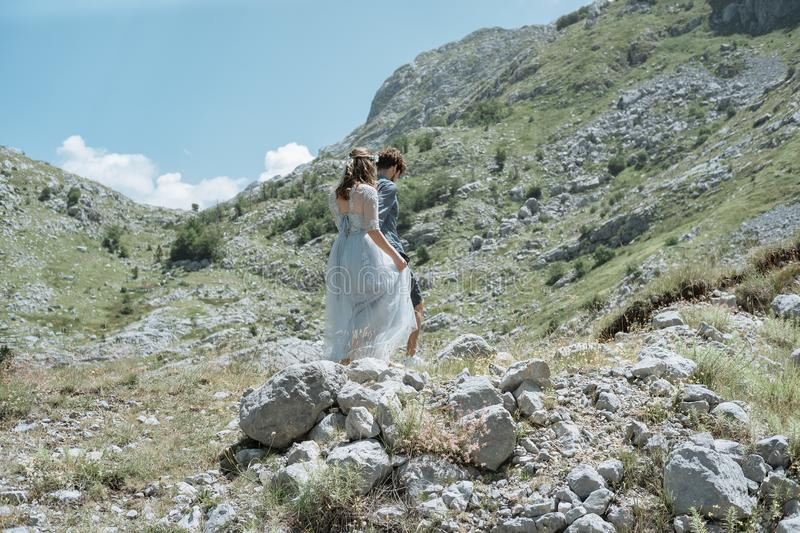 Romantic couple walking along the road against the background o royalty free stock photos