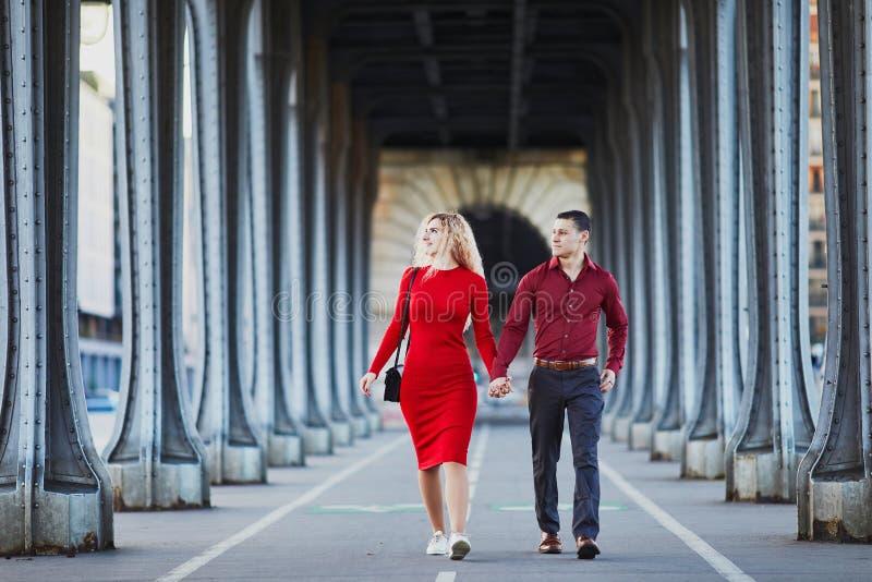 Romantic couple walking on Bir-Hakeim bridge in Paris, France stock images