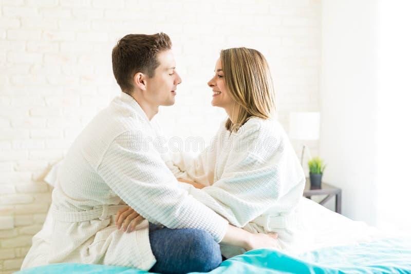 Romantic Couple Wearing Bathrobes In Bedroom stock photo