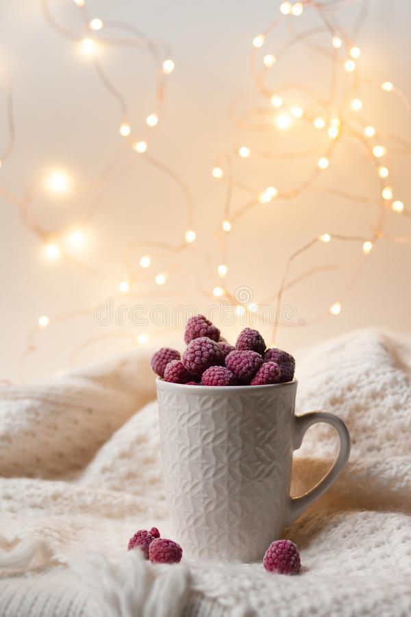 Romantic and cozy breakfast: frozen raspberries served in a white cup stock photos