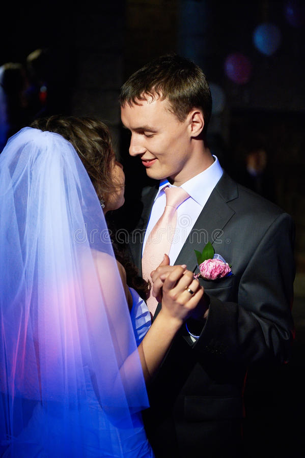 Romantic dance young bride and groom stock photos