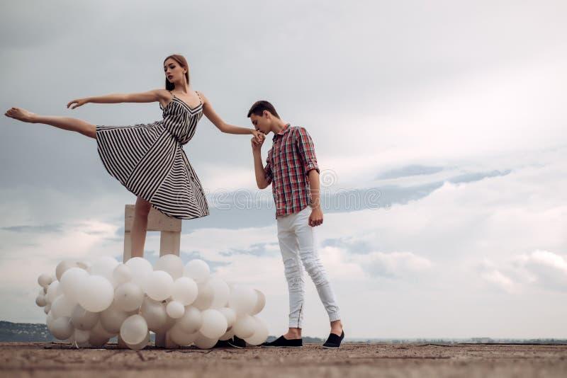 Romantic date. Ballet couple into love relations. Couple in love. Ballet dancers falling in love. Romantic relations. Between ballerina and ballet partner stock image