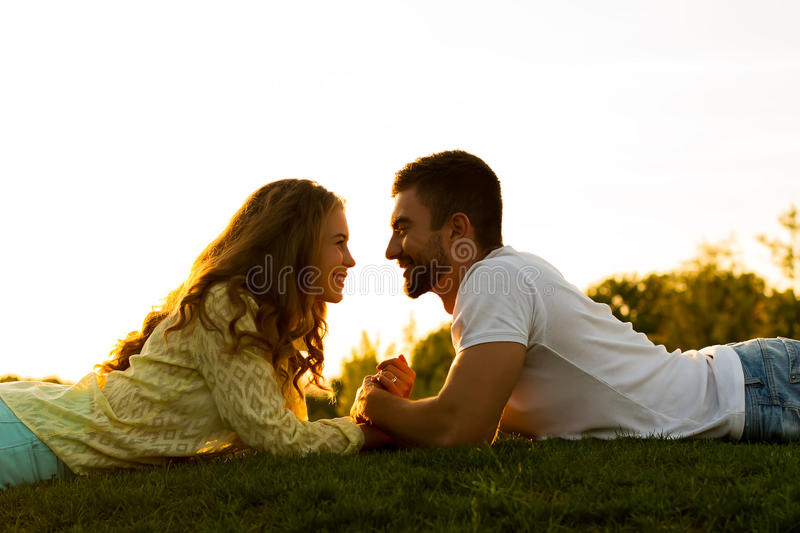 Romantic date. Love story. Guy tells a girl about love. A date at sunset. Romantic date. Love story royalty free stock photos