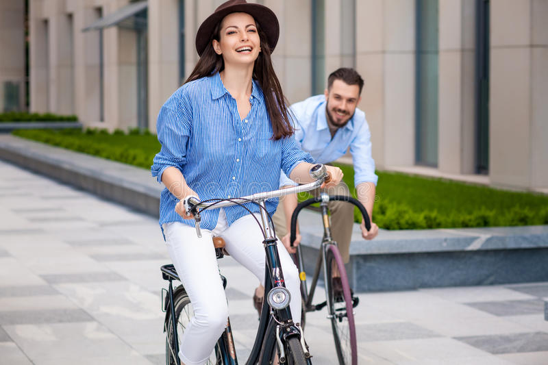 Romantic date of young couple on bicycles. At street royalty free stock photos