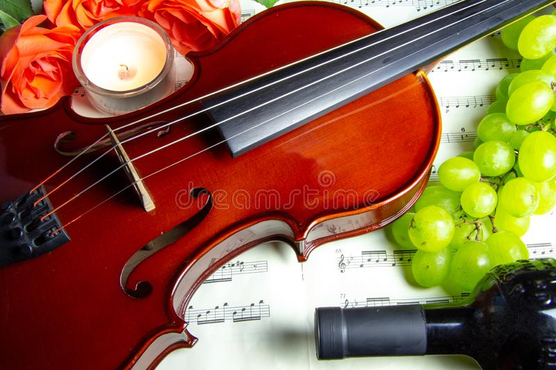 Romantic decoration of violin and wine stock photo