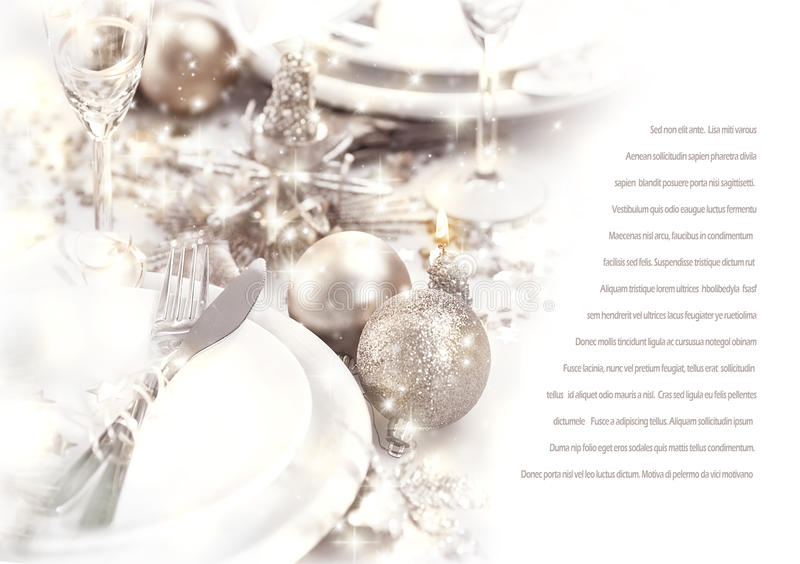 Romantic dinner. Image of romantic holiday dinner, festive table setting decorated with beautiful silver bubbles and candles, luxury white plate served with royalty free stock photos