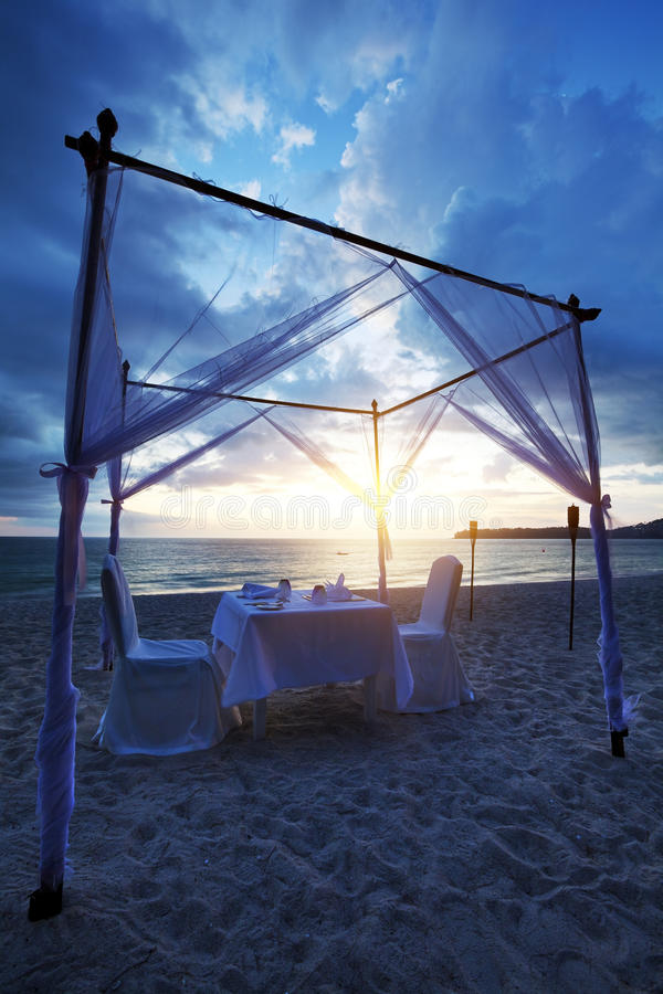 Romantic dinner on the beach stock photography