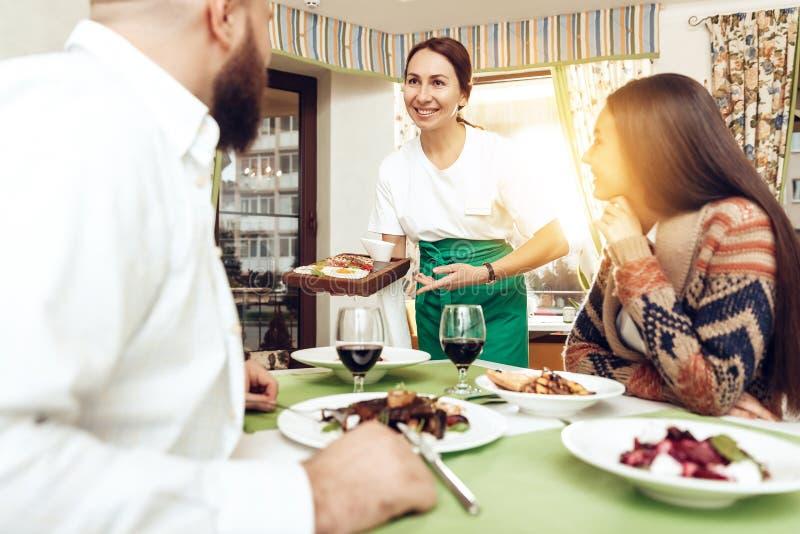 Romantic dinner happy men and women in restaurant stock images