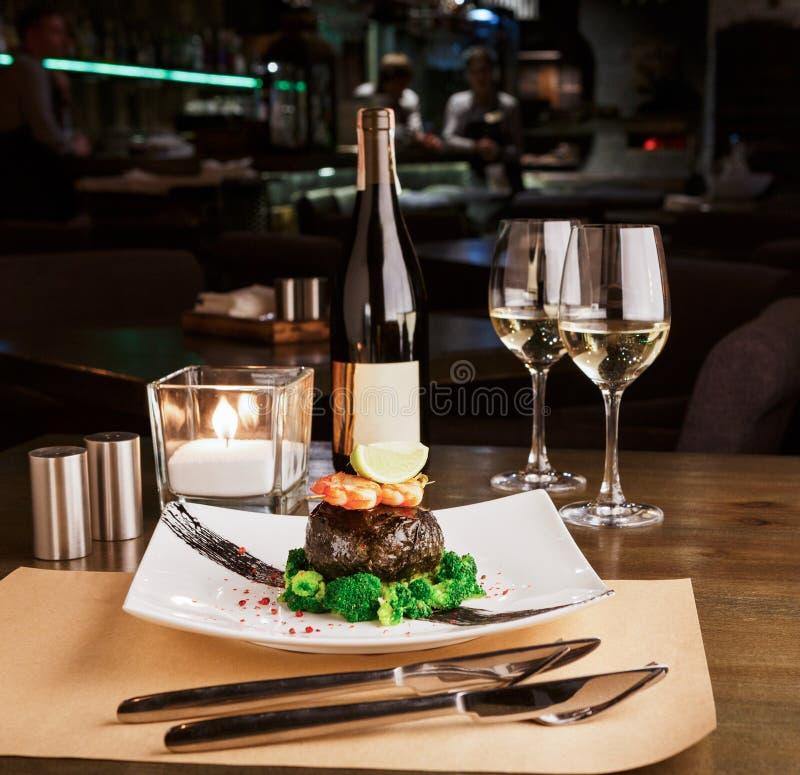 Romantic dinner at luxurious restaurant. Dorado fillet in nori with shrimps stock photography