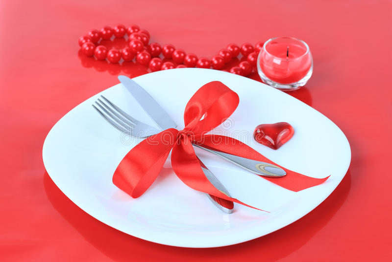 Romantic Dinner on red background stock image