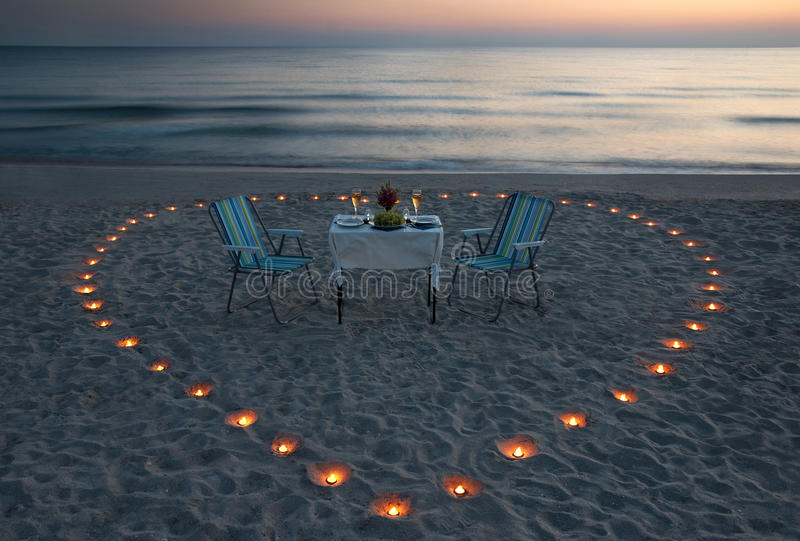 Romantic dinner on the sea beach with candle heart. In Maldives royalty free stock image