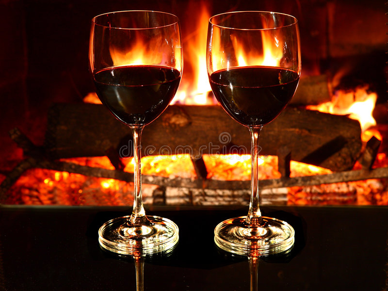Romantic dinner, wine, fireplace royalty free stock photos