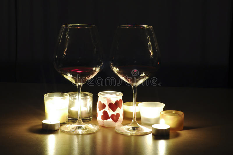 Romantic drinks. Two glasses of wine, by candle light, with a romantic theme royalty free stock photo