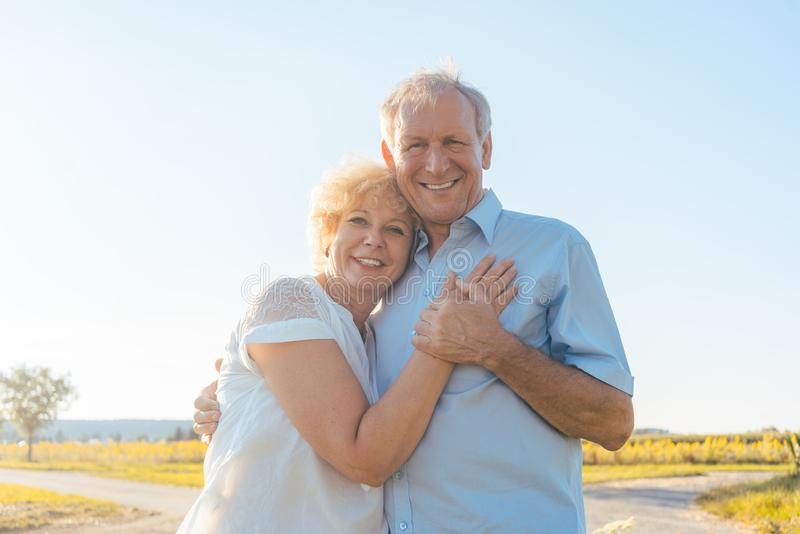 Romantic elderly couple enjoying health and nature in a sunny da stock photos