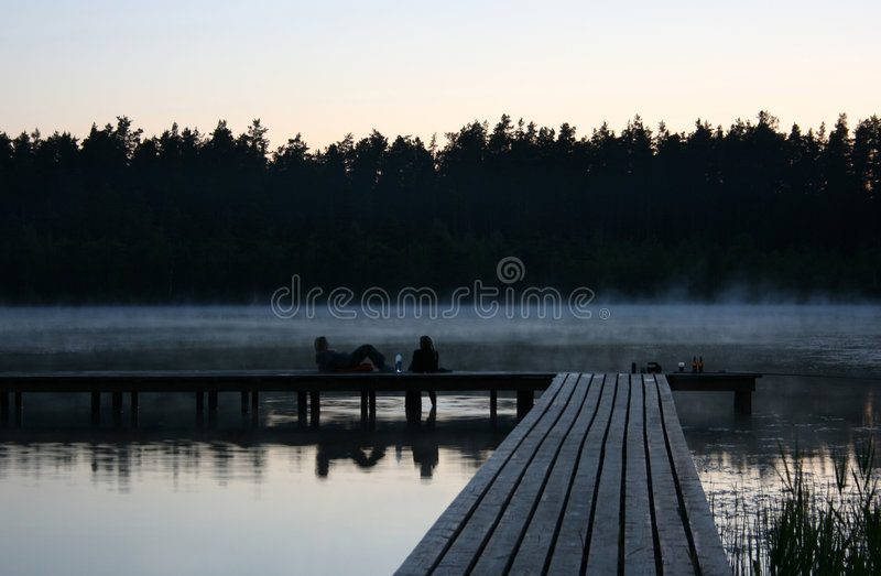 Romantic evening. At the lake with fog royalty free stock photos