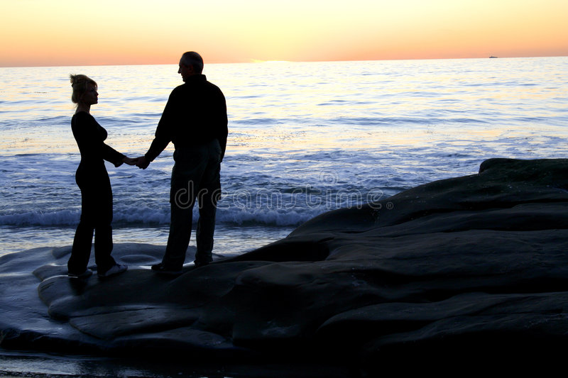 Romantic evening. Men and women waiting for sunset royalty free stock image