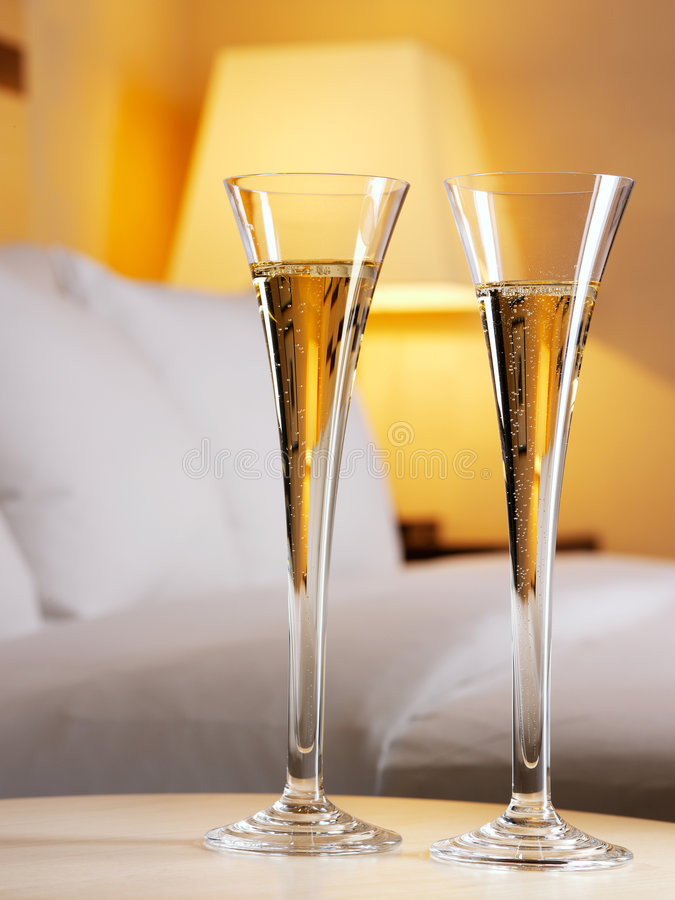 Romantic evening. In an interior with a glass of a champagne royalty free stock image