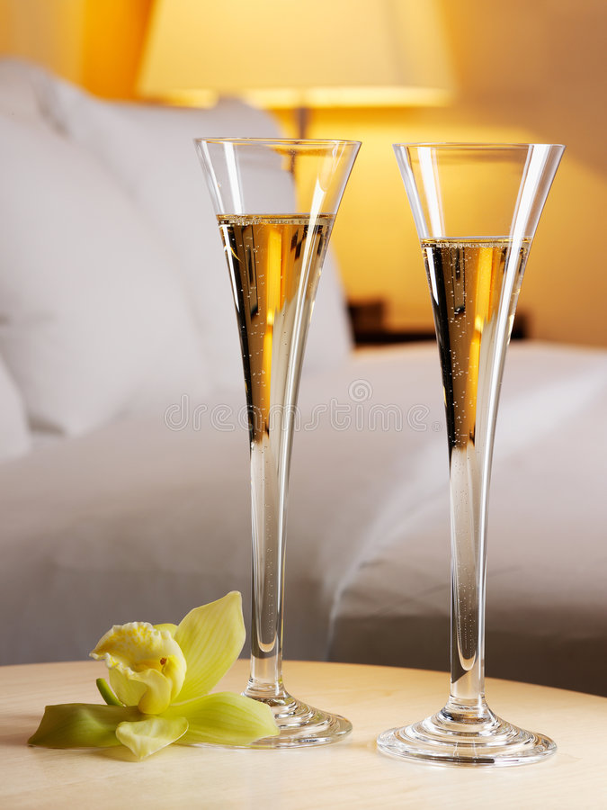 Romantic evening. In an interior with a glass of a champagne stock images
