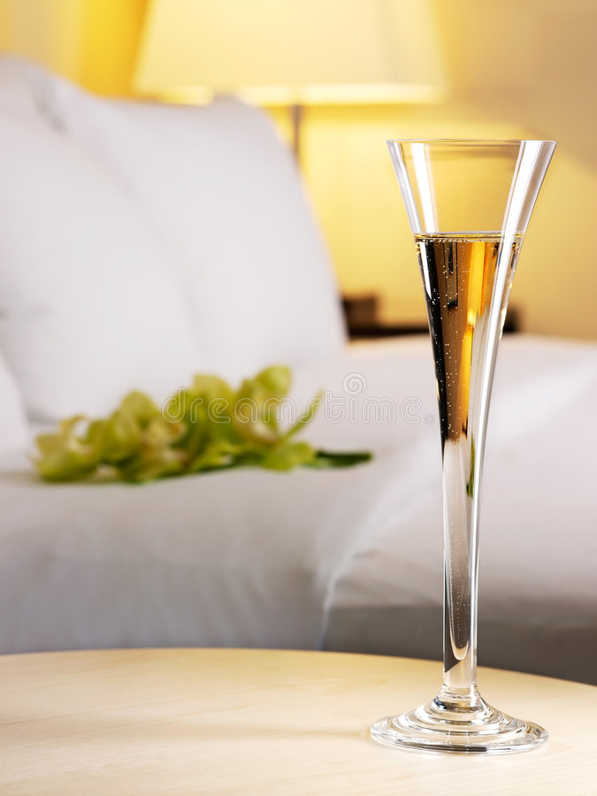 Romantic evening. In an interior with a glass of a champagne royalty free stock photos