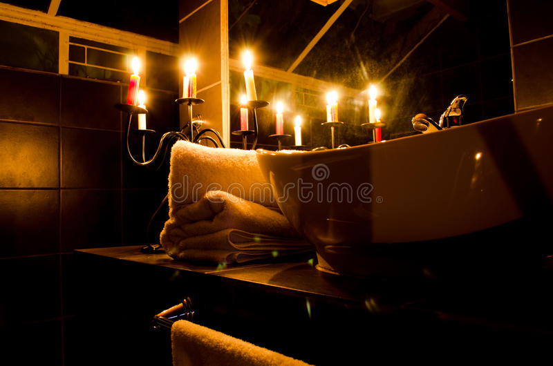 Romantic evening. In bathroom with candle light in four star accommodation royalty free stock photo