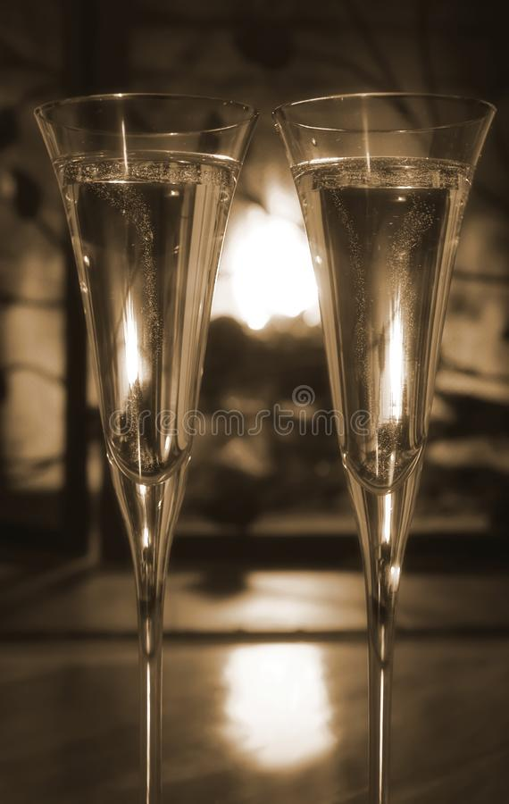 Romantic evening by the fire-sepia royalty free stock photography