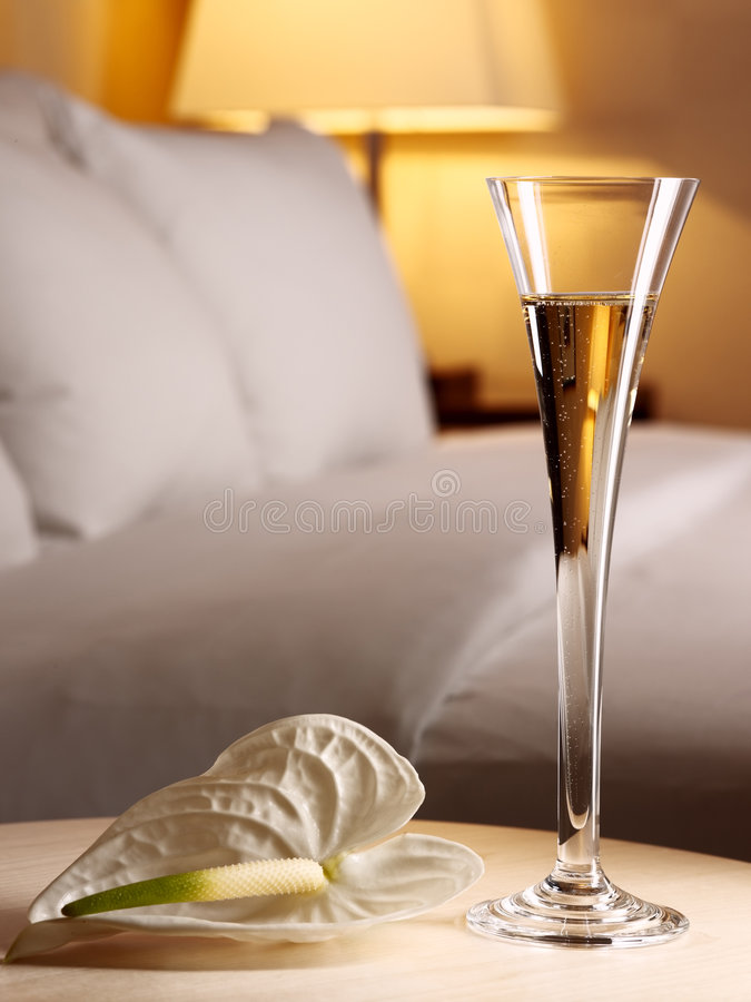 Romantic evening in an interior. With a glass of a champagne stock image