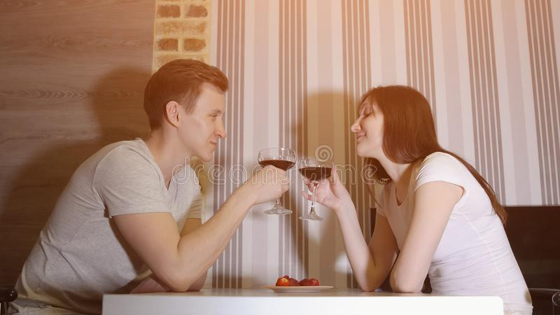 Romantic evening. Man and woman at the table drinking wine. Romantic evening. Man and women at the table drinking wine, sunlight royalty free stock photo