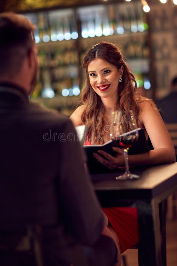 Romantic evening in restaurant. Elegant couple spend romantic evening in restaurant royalty free stock image