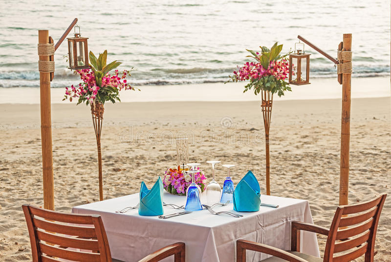 Romantic Evening Table Beach. Romantic evening table for two persons on the beach stock photography