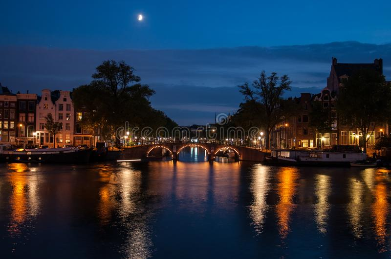 Romantic evening view - amsterdam. Romantic evening view over a canal in amsterdam stock images