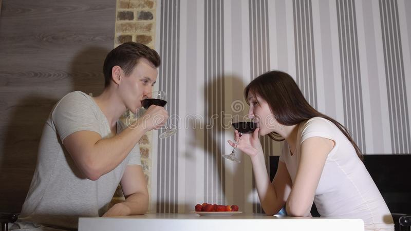 Romantic evening. Young couple at a table drinking wine.  royalty free stock photo