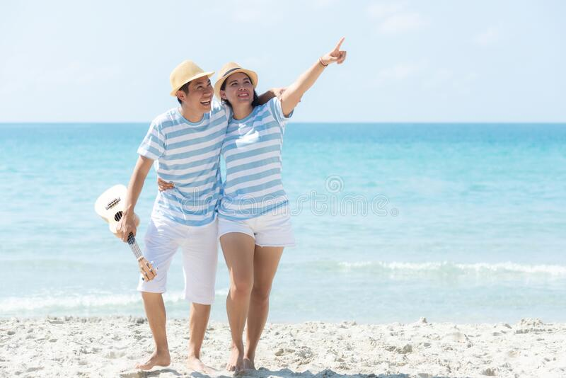 Romantic family asian couples lover relax and dance music enjoy for honeymoon in luxury resort near the beach in Summer holiday. royalty free stock images