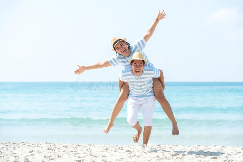Romantic family asian couples lover relax and enjoy for honeymoon in luxury resort near the beach in Summer holiday. royalty free stock images