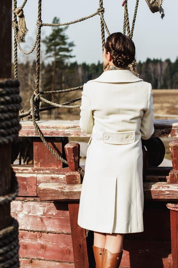 Romantic fashion portrait of a beautiful woman on a ship stock image