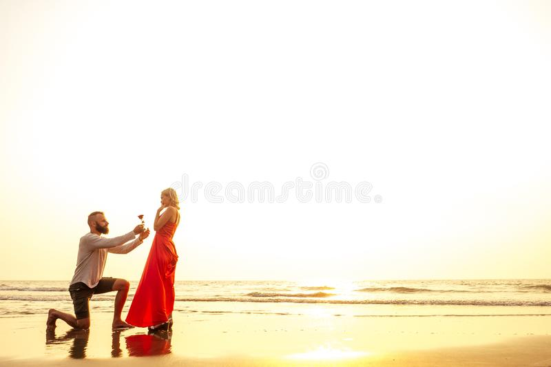 Romantic February 14 Valentine`s Day summer holidays, relationship dating.love couple with bouquet flowers man in a. Romantic February 14 Valentine`s Day summer royalty free stock photo