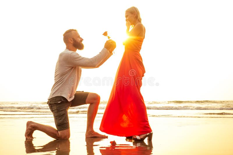 Romantic February 14 Valentine`s Day summer holidays, relationship dating.love couple with bouquet flowers man in a. Romantic February 14 Valentine`s Day summer royalty free stock photos