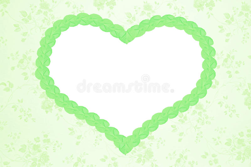 Romantic floral background with green heart royalty free stock photo