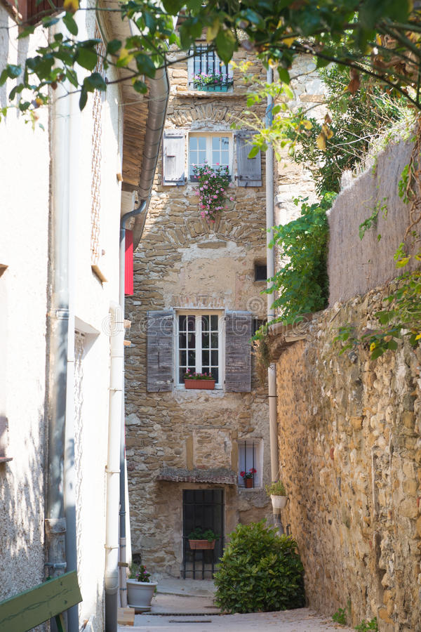 Romantic French lane. Romantic French little lane with houses and flowers stock photography