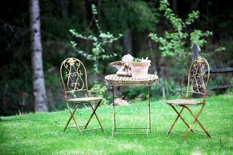 Romantic garden patio royalty free stock photos