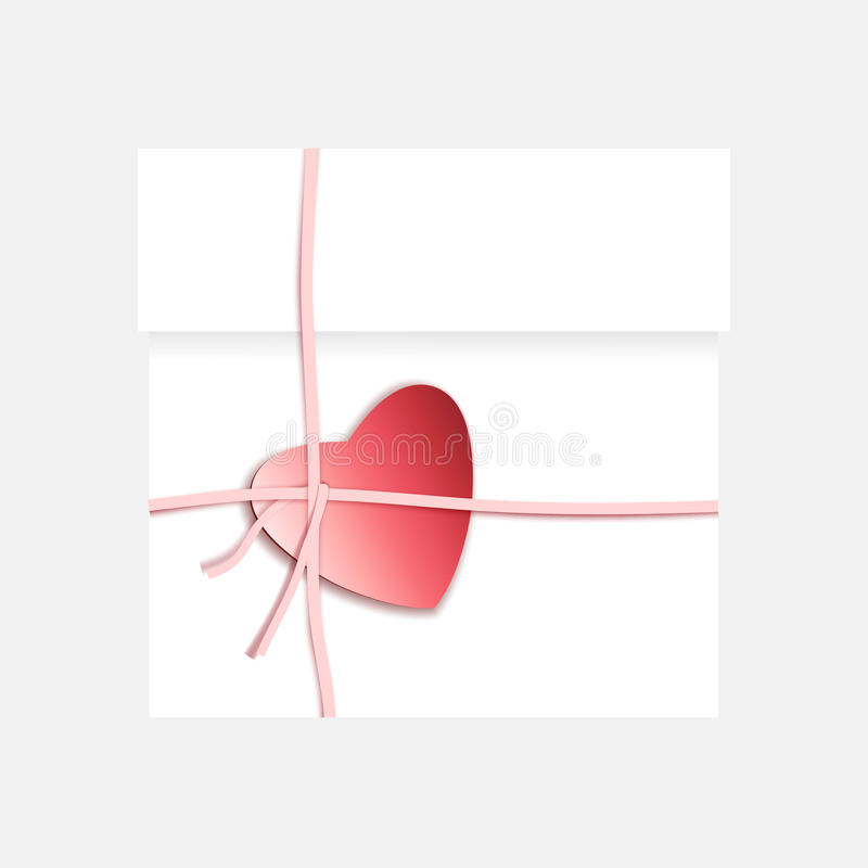 Romantic gift package with paper ribbon and red heart royalty free stock images