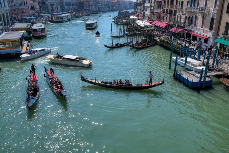 Romantic gondola ride in the canals of Venice, Italy royalty free stock images