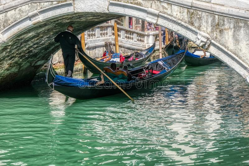 Romantic gondola ride in the canals of Venice, Italy royalty free stock photography