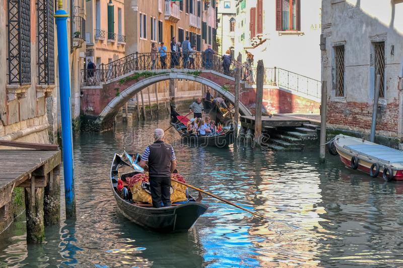 Romantic gondola ride in the canals of Venice, Italy royalty free stock photo