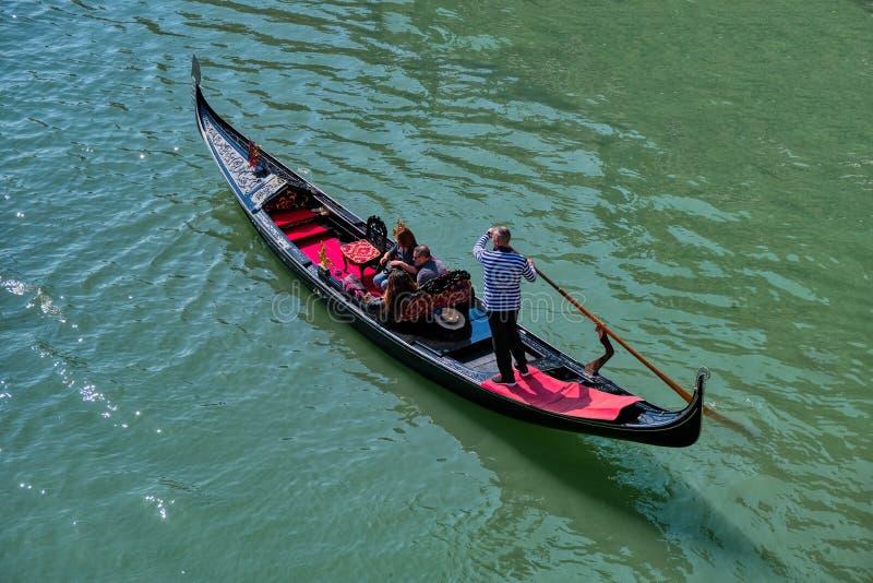 Romantic gondola ride in the canals of Venice, Italy stock photo