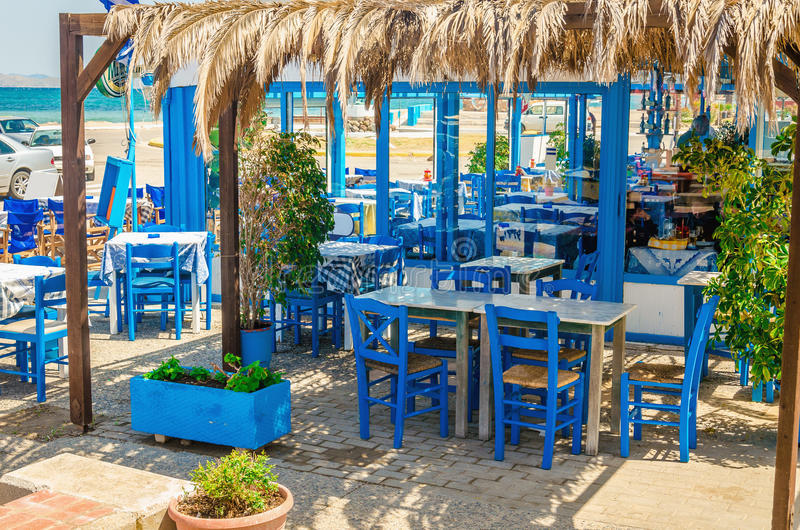 Romantic greek restaurant with blue chairs greece stock