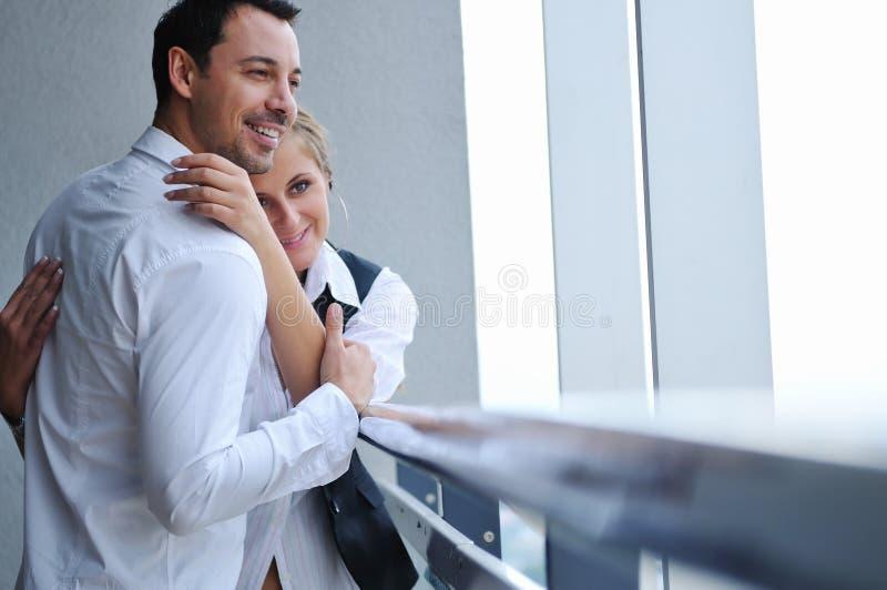 Romantic happpy couple on balcony stock photo
