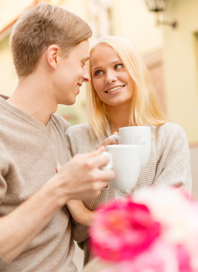 Romantic happy couple in the cafe stock image