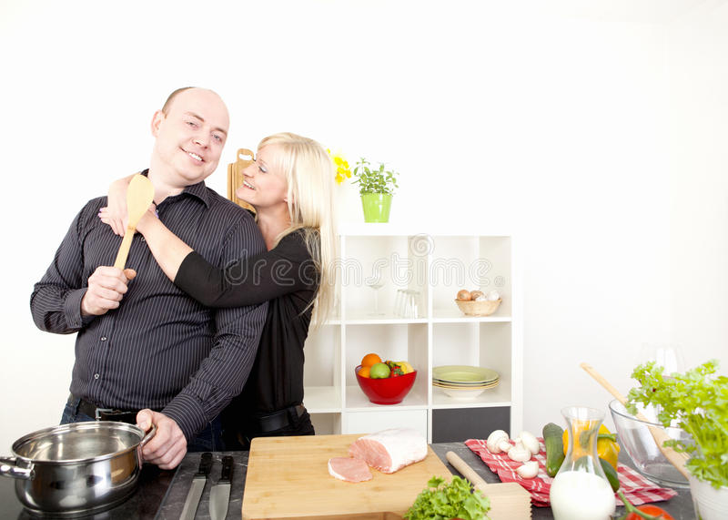 Romantic happy couple preparing a meal royalty free stock photos