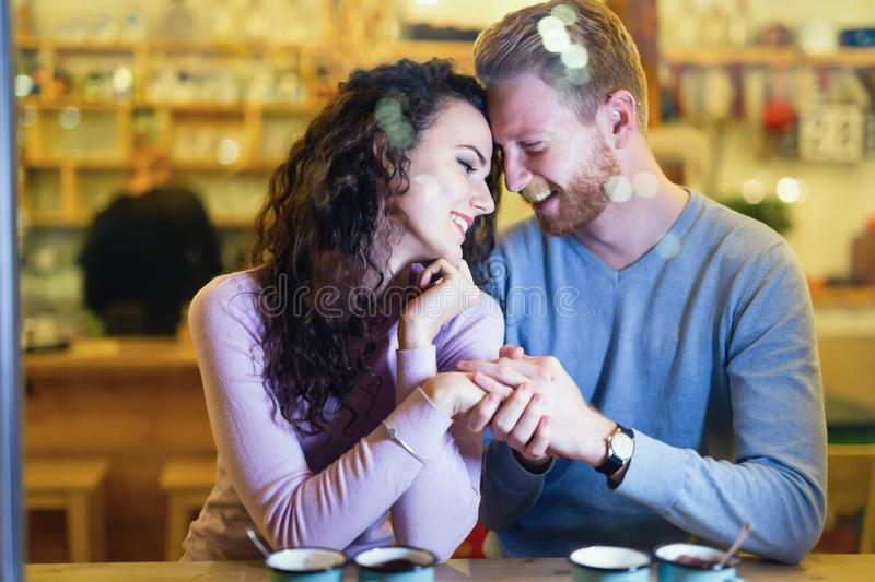 Romantic couple having date in coffee shop. Romantic happy couple having date in coffee shop stock photography